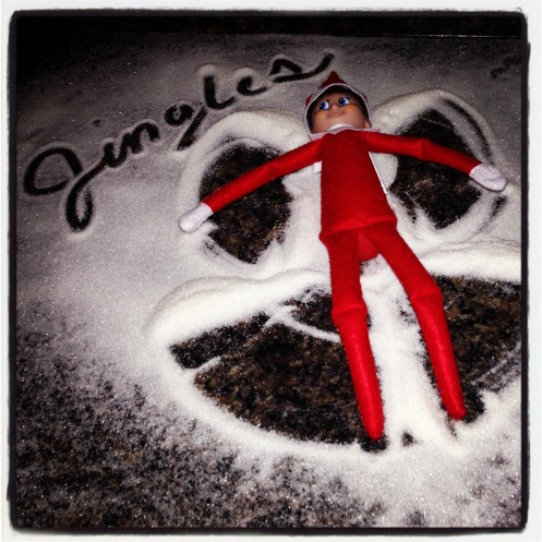 Jingles the Elf making a sugar snow angel at my brother's house. Photo Cred: my brother