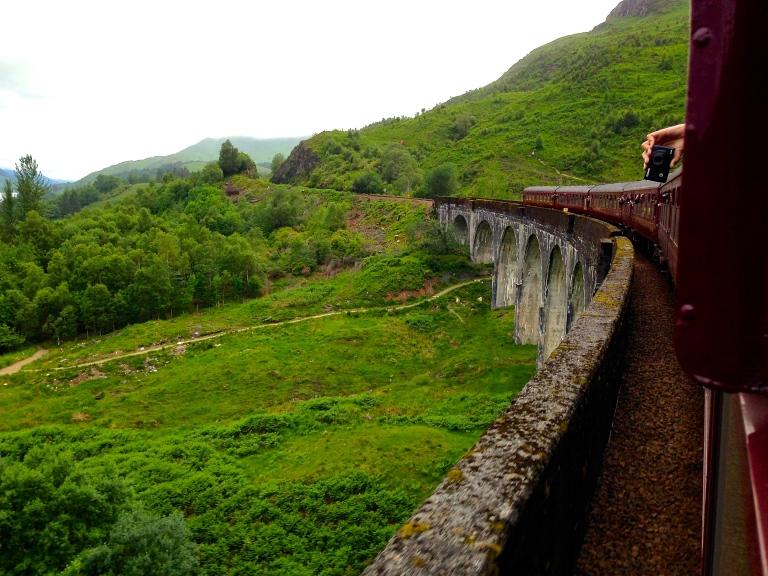 Aboard the Jacobite Steam Train from Fort William to Mallaig, taken over the Glenfinnan Viaduct, aka the scene from when Harry Potter goes to Hogwarts.
