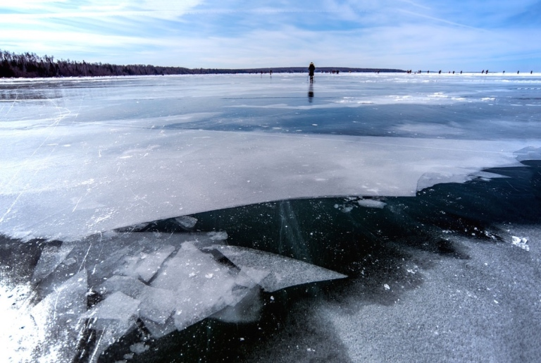 Tiny me, walking across giant icy Lake Superior. Photo Credit: my dad